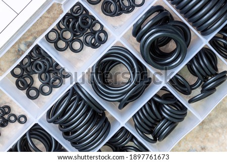 A set of rubber sealing gaskets. Rubber rings for creating tight connections in the automotive, marine and aviation industries. Royalty-Free Stock Photo #1897761673