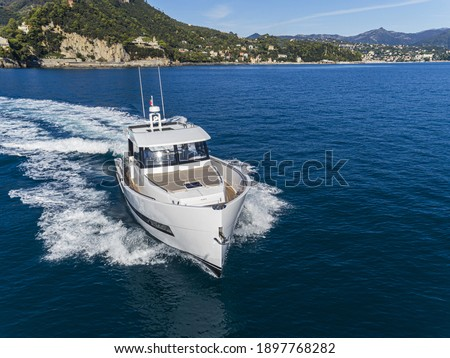 motor yacht in navigation aerial drone view Royalty-Free Stock Photo #1897768282
