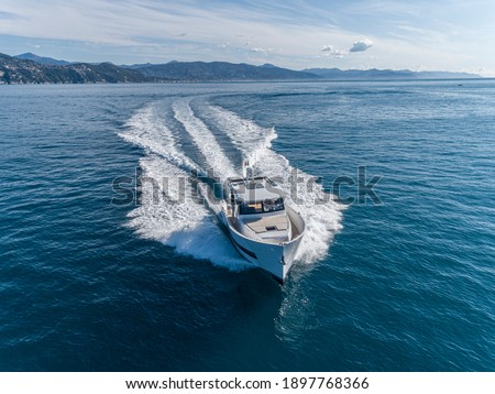 motor yacht in navigation aerial drone view Royalty-Free Stock Photo #1897768366