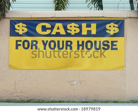 housing market exterior sign hanging on crumbling old stucco wall #18979819