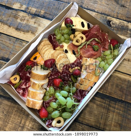 Grazing box with cheese and meat Royalty-Free Stock Photo #1898019973