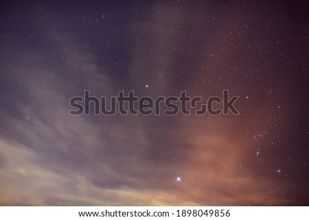 Stars Sirius and Procyon near the constellation Orion in the foggy night.