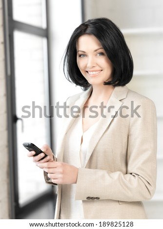 bright picture of businesswoman with cell phone #189825128