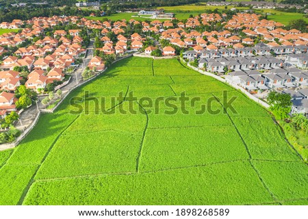 Land plot in aerial view. Include landscape, real estate, green field, crop, agricultural plant. Tract of land for housing subdivision, development, owned, sale, rent, buy or investment in Chiang Mai. Royalty-Free Stock Photo #1898268589