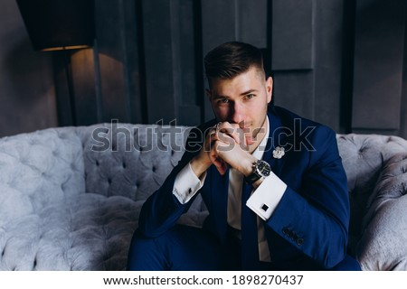 Portrait of the groom. The groom is preparing to meet the bride. Photoshoot of a successful businessman.  Royalty-Free Stock Photo #1898270437