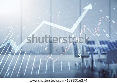 Abstract virtual financial graph and upward arrow hologram on a modern coworking room background, financial and trading concept. Multiexposure Royalty-Free Stock Photo #1898316274
