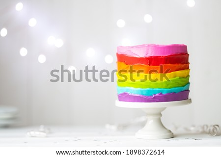 Colorful rainbow cake on a cakestand Royalty-Free Stock Photo #1898372614