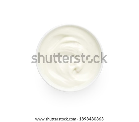 Bowl of white creamy yogurt isolated on white background, top view, flat lay Royalty-Free Stock Photo #1898480863