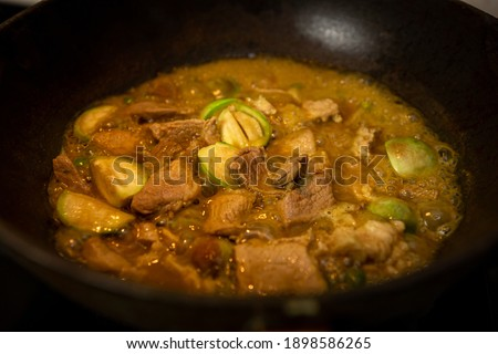 Pork green curry, Thai food and focus on pork in the center of the picture.