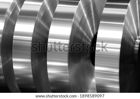 final coils of aluminum foil after sliting on the axis machine, black and white photo Royalty-Free Stock Photo #1898589097