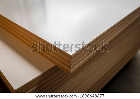 Medium-Density Fiberboard Melamine in the furniture factory. Royalty-Free Stock Photo #1898648677