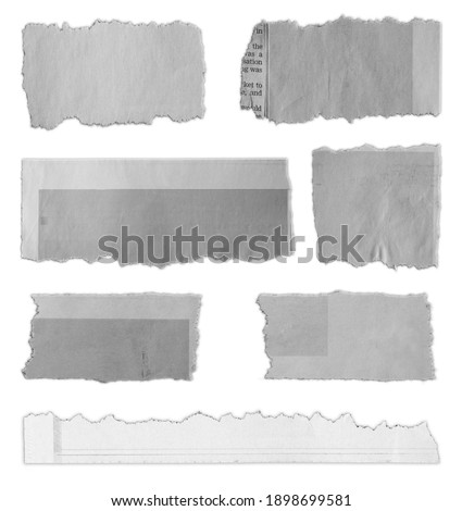 Seven pieces of torn paper on plain background  Royalty-Free Stock Photo #1898699581