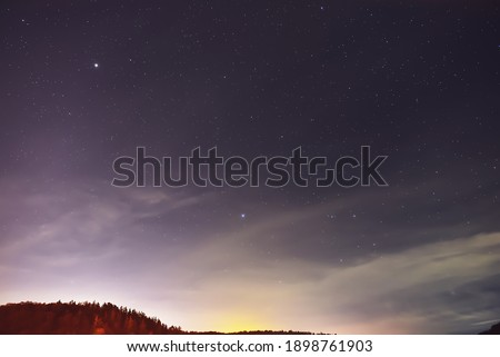 Stars Spica and Arcturus  in the foggy night.