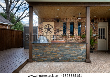 Modern outdoor kitchen that has been freshly built Royalty-Free Stock Photo #1898835151