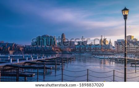 January 9th, 2021 -Buffalo NY USA: Buffalo cityscape view at early cold morning from erie basin marina.