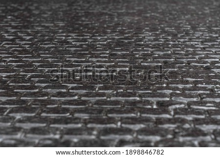 Snowy sleet road, icy road, ice. footpath in the city winter frozen of ice and snow is slippery. The icy area covered with stone pavers after an icy rain Royalty-Free Stock Photo #1898846782
