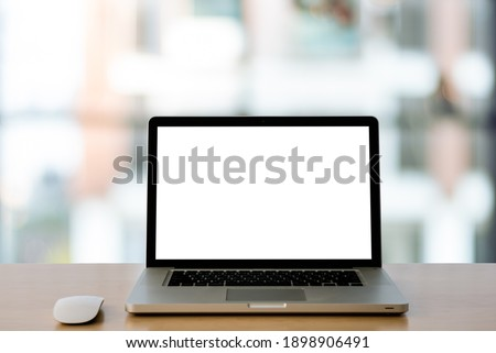 Empty space,Wooden table with Laptop with blank screen,blurred background of bokeh. - Image Royalty-Free Stock Photo #1898906491
