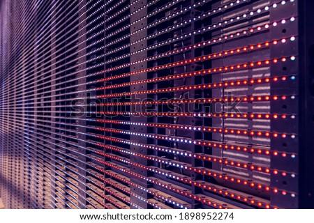 LED Outdoor Media Facade, digital signage screen. Exterior facade light, wall LED pixels light, architectural media lights
