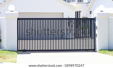 Steel automatic sliding open front gate Royalty-Free Stock Photo #1898970247