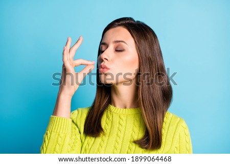 Photo of young attractive woman show gesture perfect tasty sign enjoy meal isolated over blue color background Royalty-Free Stock Photo #1899064468