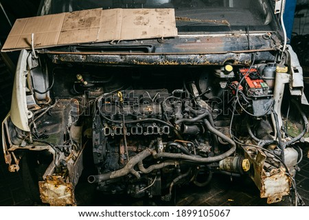 The hood of a dismantled car. Dismantled old bus. Dismantled engine of a car under repair Royalty-Free Stock Photo #1899105067