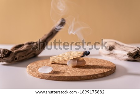 Peruvian palo santo holy wood smoke. Esoteric objects for meditation, antistress and relaxation purifying concept. Smudge kit for spiritual practices. Royalty-Free Stock Photo #1899175882