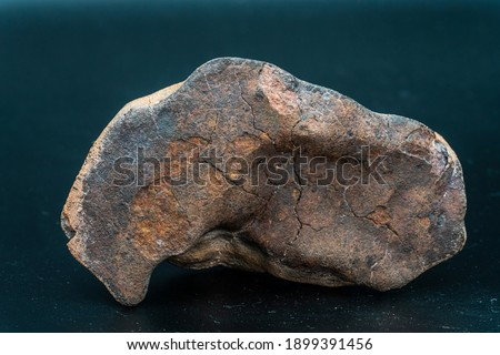 Chondrite Meteorite isolated, piece of rock formed as an asteroid in the universe at during Solar System creation. The meteorite comes from an asteroid fall impacting Earth at Atacama Desert