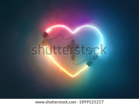 A glowing neon heart shape that is plugged into a cross. Royalty-Free Stock Photo #1899525217