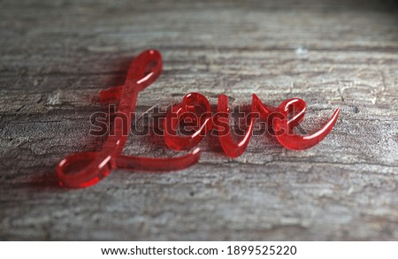 The word Love is spelled out in glass on a wooden background Royalty-Free Stock Photo #1899525220