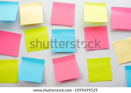 Blank Sticker notes on the white background. Mockup sticky Note Paper. Business people meeting and use post it notes to share idea on sticky note.Discussing business, teamwork, brainstorming concept Royalty-Free Stock Photo #1899699529