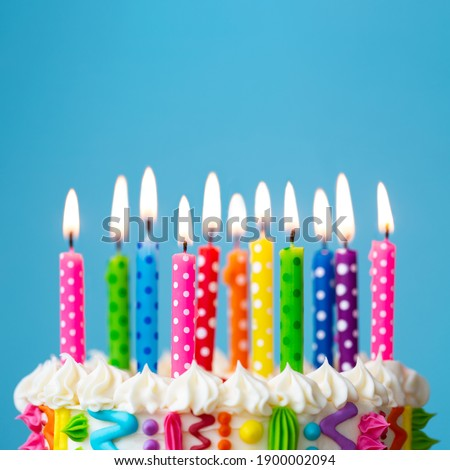 Colorful birthday cake with rainbow colored candles Royalty-Free Stock Photo #1900002094