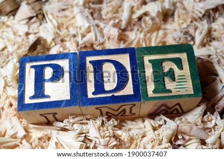 The Portable Document Format (PDF) acronym arranged with wooden blocks