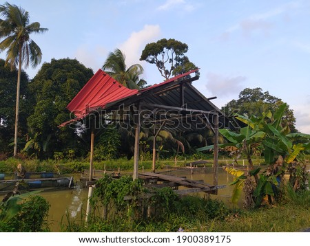 The old River Cabin is a rustic log home, picture take at village in the kelantan, Malaysia.