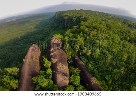 Beautiful landscape of Three Whale Rock or Hin Sam Wan an attractions in Bueng Kan province Thailand. (The pictures has noise and soft focus)