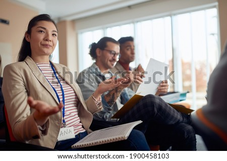 young asian female discussing at business conference, explaining her opinion