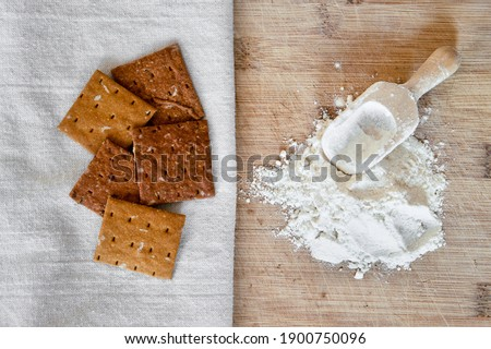 Cricket insect crackers snack and cricket flour for eating as food items made of cooked insects as a good source of protein. Entomophagy concept. The concept of protein food sources from insects. Royalty-Free Stock Photo #1900750096