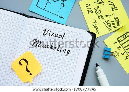 Business concept about Visual Marketing with phrase on the piece of paper.