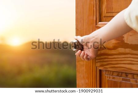 Grand opening women hand open door knob or opening the door, grand opening, Close up hand open door. Royalty-Free Stock Photo #1900929031