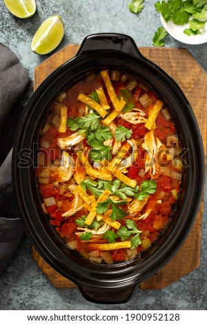 Slow cooker chicken taco soup topped with fresh cilantro Royalty-Free Stock Photo #1900952128