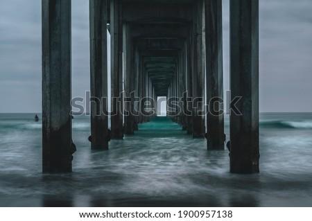 Waves coming in underneath Scripps Pier in La Jolla, San Diego California  Royalty-Free Stock Photo #1900957138