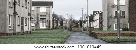 Derelict council house in poor housing estate slum with many social welfare issues in Port Glasgow Royalty-Free Stock Photo #1901019445