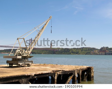 A view of Old leverage at dock and Cristo Rei statue near to River in Lisbon, Portugal. #190105994