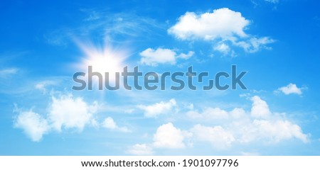 Sunny day background, blue sky with cumulus clouds and summer or spring sun as nature background. Royalty-Free Stock Photo #1901097796