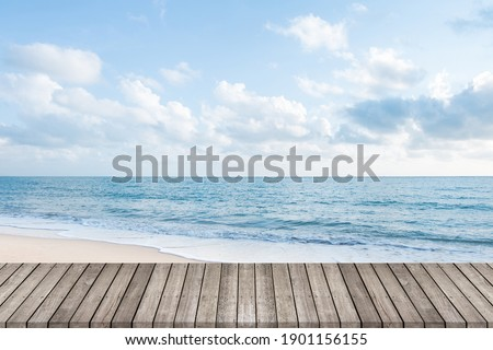 Wooden walkway with beautiful white sand beach ocean and clear blue sky background, space for product or object presentation Royalty-Free Stock Photo #1901156155
