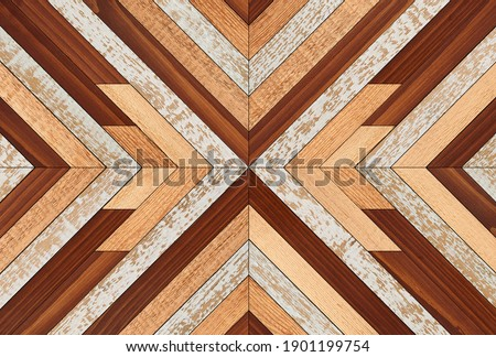 Colorful wooden wall with chevron pattern made of narrow hardwood planks. Wood texture background. Royalty-Free Stock Photo #1901199754