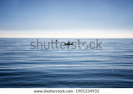 Minimalistic picture of kayak on the sea in Málaga, Spain. Relaxing sport in tranquil water.