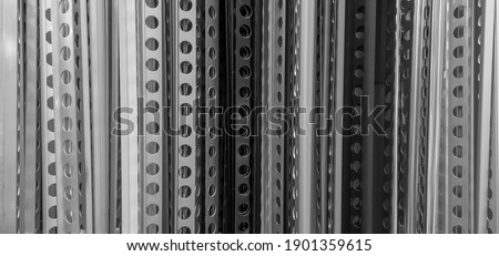 Row of many perforated angle metal beads Royalty-Free Stock Photo #1901359615
