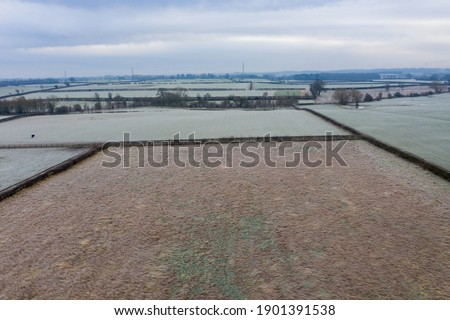 Aerial photo of the British country side taken on a cold winters frosty morning showing an aerial view of the cold British scenic rural area in the UK village of Wetherby in West Yorkshire