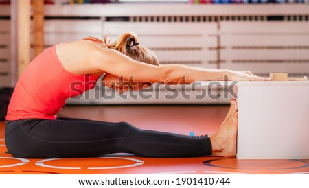 Woman doing sit and reach flexibility test Royalty-Free Stock Photo #1901410744