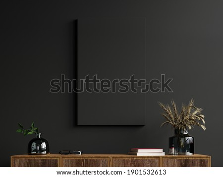 Mockup frame on cabinet in living room interior on empty dark wall background,3D rendering Royalty-Free Stock Photo #1901532613